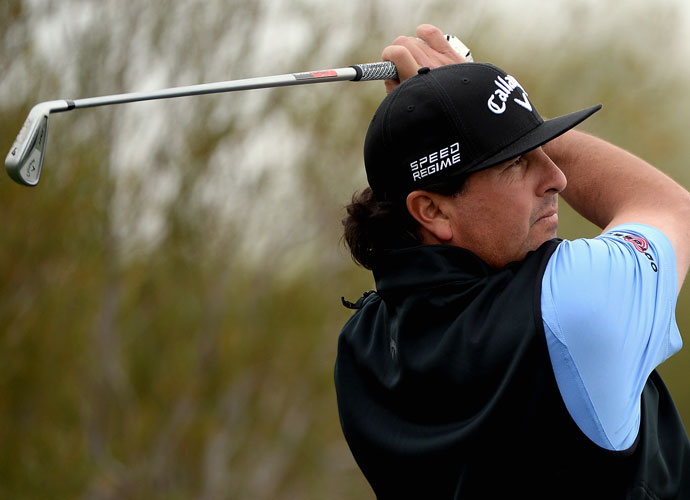 Pat Perez follows through on his shot at the 12th hole during the second round of the Waste Management Phoenix Open. Perez shot 68 and finished the day tied for fifth, three shots back.