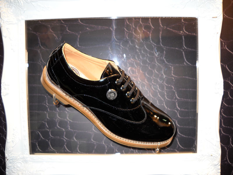 Royal Albartross Shoes                       These unusual patent-leather golf shoes seem whimsical, but they are quite serious. Royal Albartross shoes have a waterproof membrane and leather-rubber sole with Champ Q-Lok cleats. Down low, right where you want it, is a magnetic ball marker. ($595)