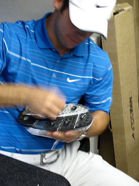 was a blur inside the Nike Tour van as he swapped out his soft spikes in favor of quarter-inch metal spikes.