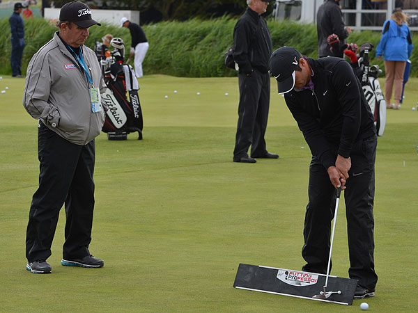 "Peter Kostis got a double dose of Peter Kostis, his coach, on the practice green Wednesday. As Kostis watched, the Englishman used Kostis's ""Putting Professor"" training aid to groove his stroke."
