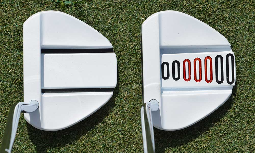 On the left is a new TaylorMade Ghost Manta putter. On the right is a Ghost Manta made especially for Paul Goydos.