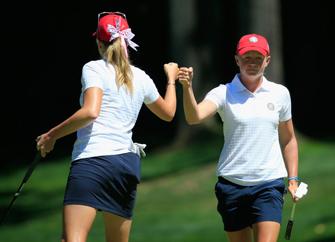 Paula Creamer (left) and Stacy Lewis celebrate after putting out during the second day of the LPGA Crown Invitational at Caves Valley Golf Club in Owings Mills, Maryland. This is the first year of the event, which includes four-player teams from eight countries competing in match play to earn global bragging rights.
