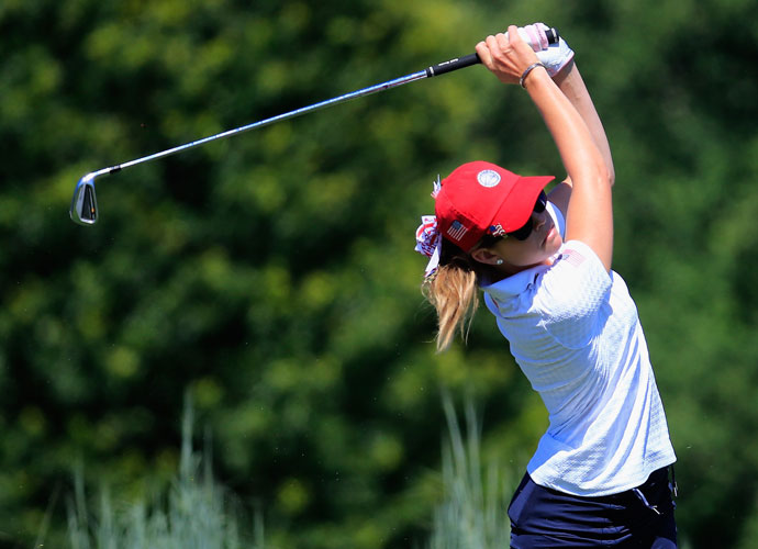 The American team's Paula Creamer tees off on the 17th hole during the second-round win over Spain.