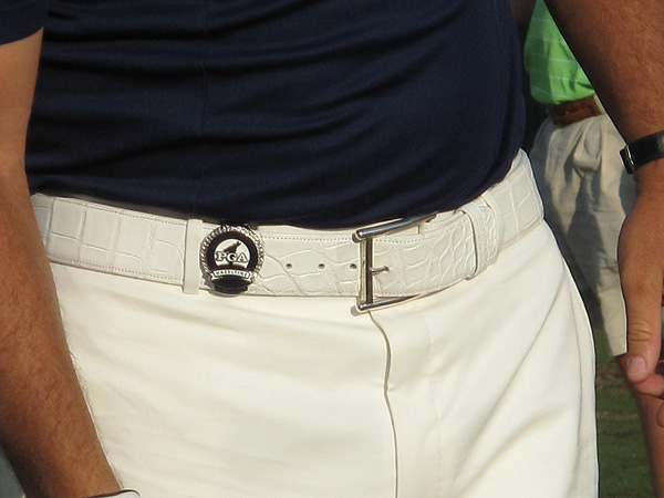 wore the money clip given to each competitor at the PGA Championship on his white alligator-skin belt.