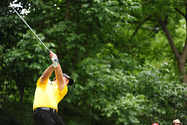Phil Mickelson's powerful swing made the wet, 7,324-yard course play shorter Saturday morning.