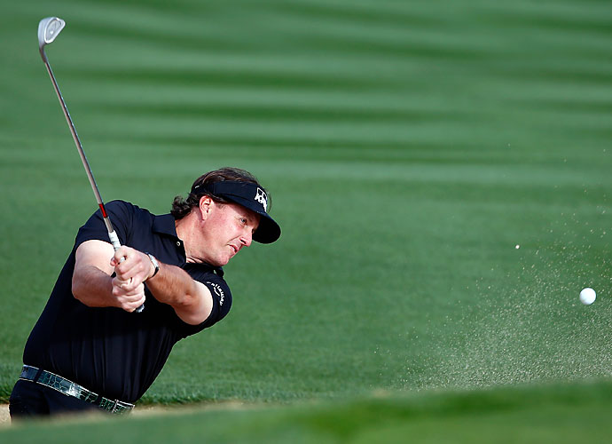 Phil Mickelson plays a shot from the sand during the third round of the Waste Management Phoenix Open. The defending champion shot a 1-over 72 and is -3 heading into Sunday.
