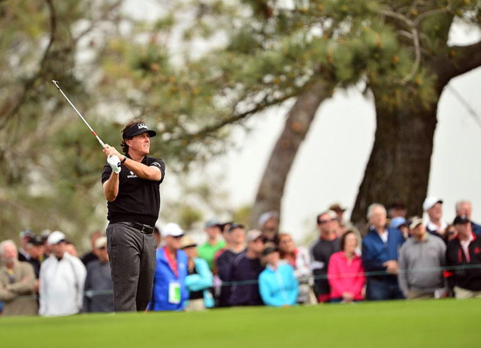 Mickelson plays his fourth shot at the par 5, 10th hole.