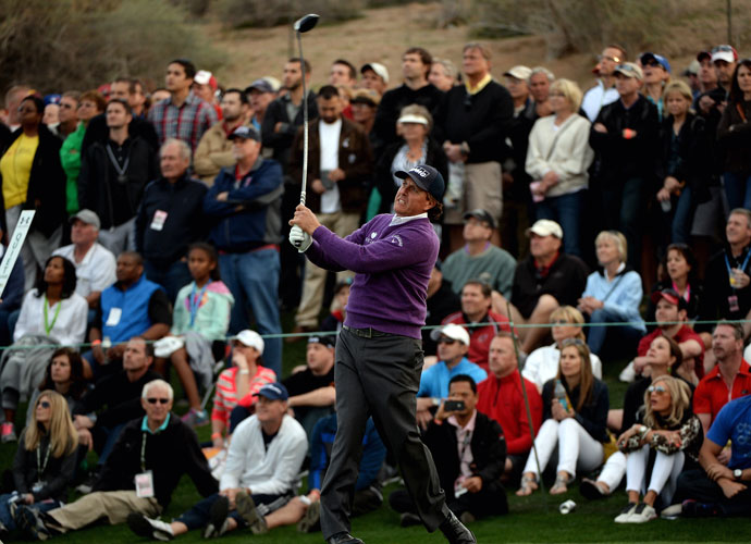 Defending champion Phil Mickelson watches his tee shot during the second round of the Waste Management Phoenix Open.