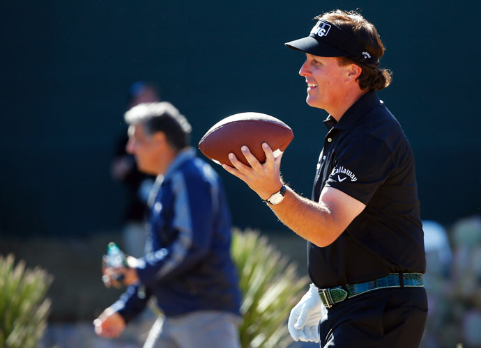 Phil Mickelson gets ready to show off his arm strength on the 16th hole.