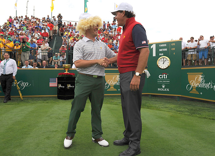 Phil Mickelson took photos with Oosthuizen before their match.