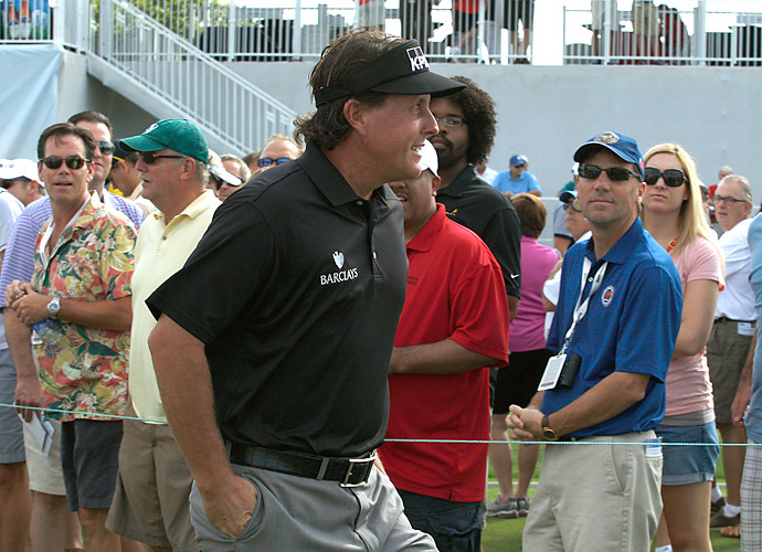 Phil Mickelson birdied three of his last five holes to salvage his round and shoot 70.