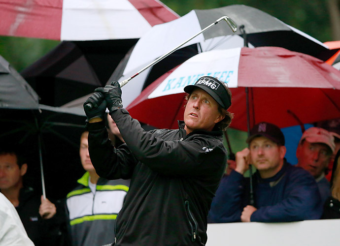 Phil Mickelson got in a few holes Sunday before finishing his round Monday. He shot a 71.