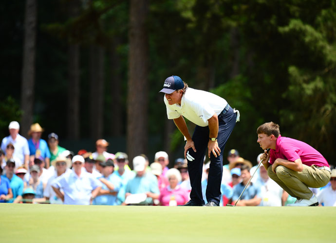 Phil Mickelson and Matthew Fitzpatrick line up their putts. Fitzpatrick, an amateur, shot 71-73 to make the cut, T44.