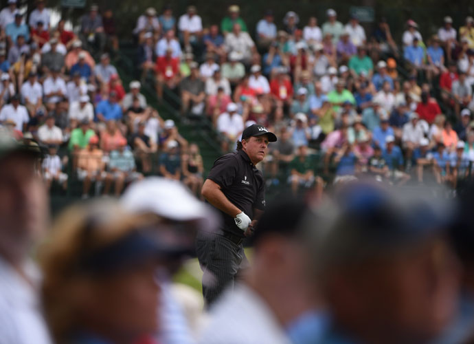 Phil Mickelson watches the flight of his tee shot in the opening round. He shot even-par 70.