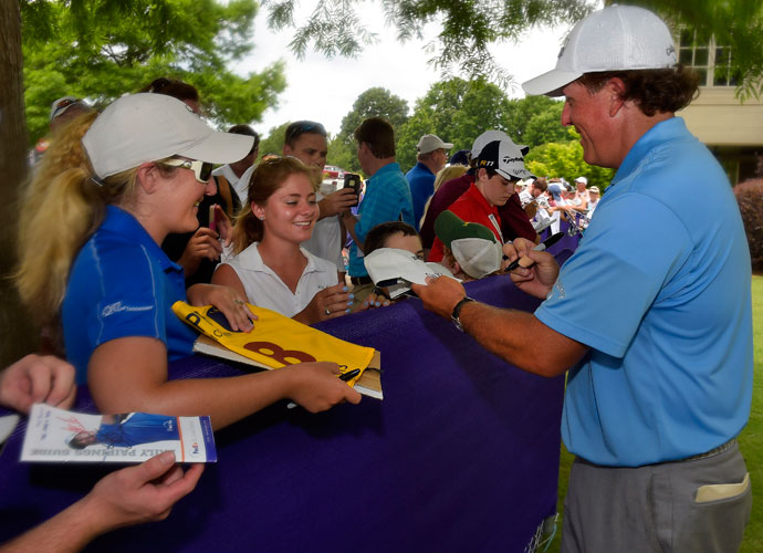 "Phi Mickelson signs autographs for fans at TPC Southwind following his opening round. He birdied three of his final four holes. ""I've been struggling with finishing the round strong,"" he said. ""I had a good round last week on Thursday and then played poorly. To birdie three of the last four made it a great round. That's exactly what I need to do."""