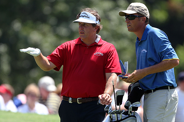 Phil Mickelson and his caddie, Jim McKay, talked strategy Saturday. The 2005 PGA Championship winner shot 75 and is tied for 58th going into the final round.