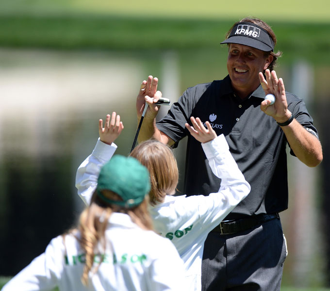 Phil Mickelson was congratulated by his children after finishing the Par 3 Contest.