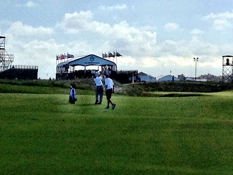 "Phil Mickelson with caddie Jim ""Bones"" Mackay during their Monday evening practice round."