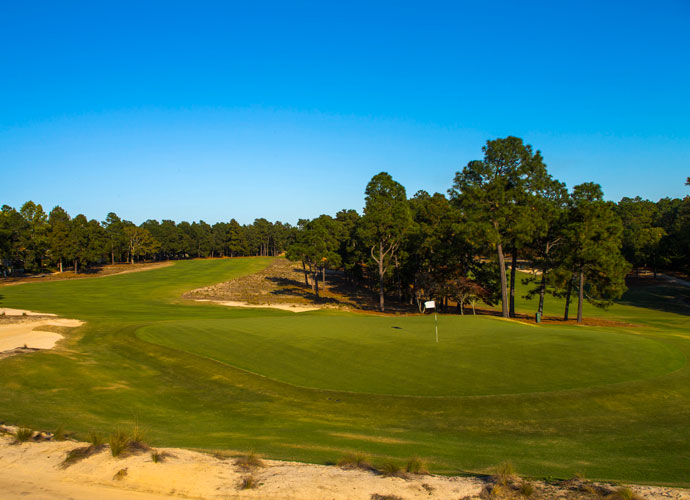 "There's Almost No Place To Locate the Hole on No. 5                         Pinehurst's most crowned green is likely that at No. 5. Designer Bill Coore likens hitting the green the placing the ball on the hood of a car, if that car is from the 1940s and has an elongated hood.  ""I've never seen anything like this,"" says Coore. ""(It's) crowned so severely that you can only place the pin in the middle .. I'm not sure there's a green in golf where the usable square footage for hole locations is so small relative to the overall size of the green."""