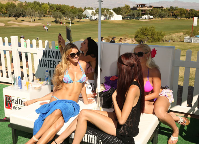 "A few golf fans lounge poolside. ""We wanted to really take a page from the energy in Las Vegas and elevate the fans' experiences inside our tournament,"" said tournament director Adam Sperling."