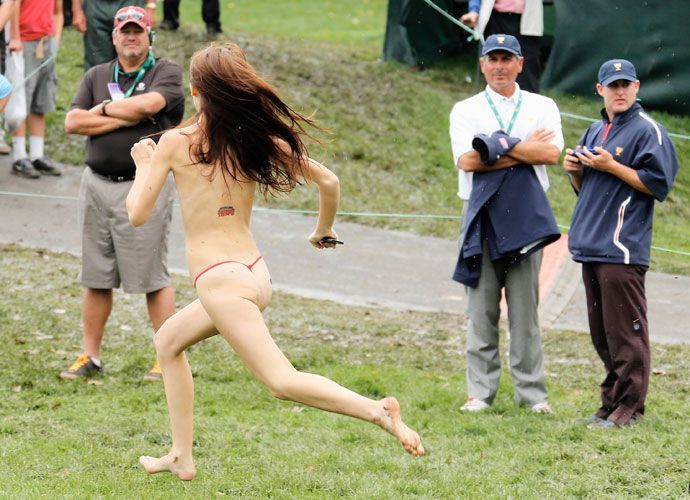 A woman streaked right past U.S. captain Fred Couples on the 18th hole at Muirfield Village.