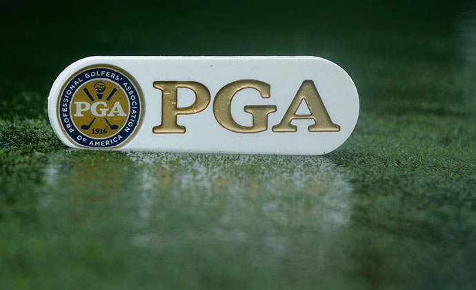 Standing water is seen on the first tee during a weather-delayed final round of the 96th PGA Championship.