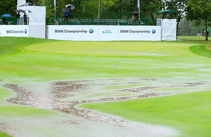 Sunday                       Heavy rain showers flooded the course Sunday causing multiple rain delays before play was called for the day.