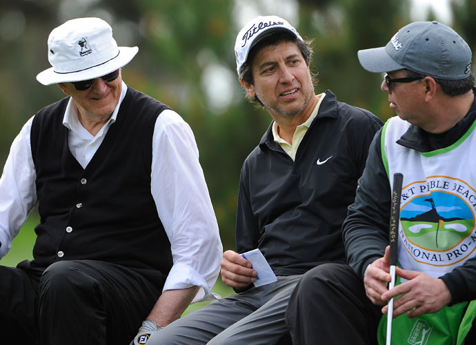 Ray Romano (center) and musician T Bone Burnett wait their turn on the tee during the 2014 AT&T Pebble Beach National Pro-Am. Romano plays to a 14.8 out of Lakeside Golf Club.