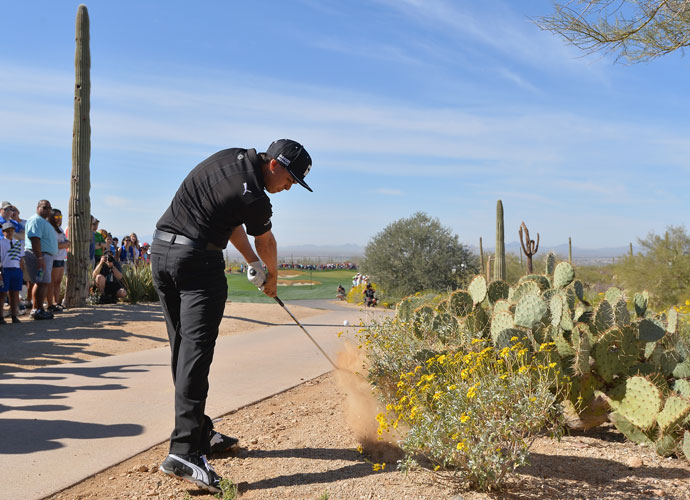 Rickie Fowler plays a shot from the desert on the second hole of his quarterfinal match against Jim Furyk. He birdied the hole and won the match, 1 up.