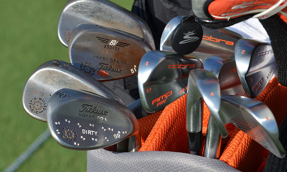 "Rickie Fowler uses a custom set of Cobra AMP Pro blade irons, and thanks to his caddie, Joe Skovron, his ""Dirty"" Vokey Spin Milled lob wedge actually appears to be very clean."