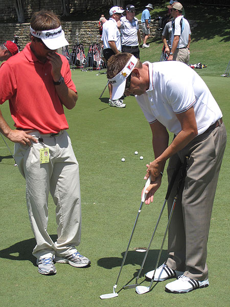 Robert Allenby studied a new TaylorMade putter on the practice green.