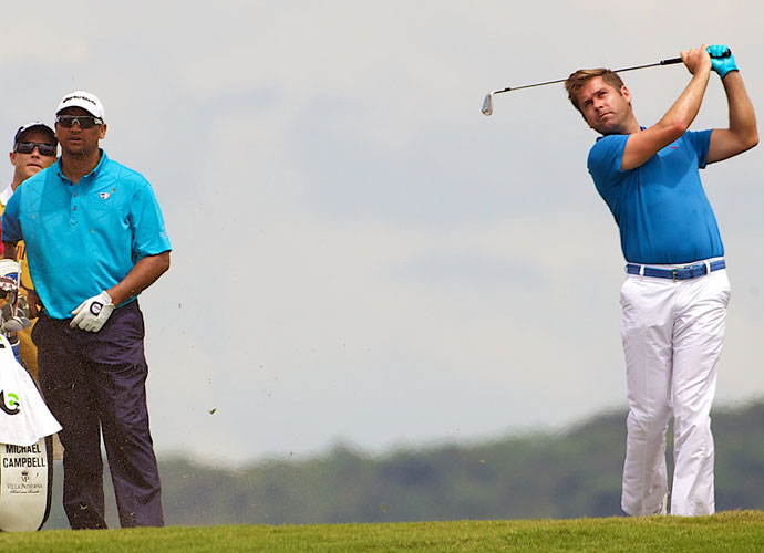 """Former U.S. Open champion Michael Campbell (left) and two-time European Tour winner Robert Rock (right) joined Norman for an exhibition match at the course's opening. """"It's just spectacular,"""" Rock said. """"It's definitely challenging, but it's also fair. I could play here every day. That's not something you can say about most courses."""" Also playing in the match were Vietnamese LPGA Tour pro Tang Thi Nhung and Ngo Bao Nghi, a native of Vietnam and member of the women's golf team at Lamar University in Beaumont, Texas."""