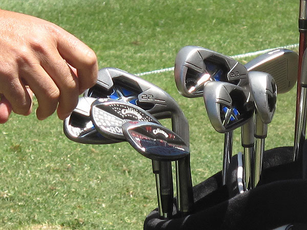 reached for one of his highly decorated Callaway wedges. He does all the stamp work himself.