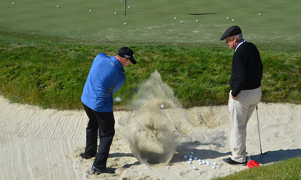Roger Cleveland, Callaway Golf's resident wedge guru, worked with Chris Devlin in one of the practice bunkers Monday morning.