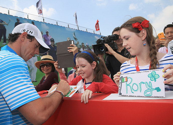 McIlroy signs an autograph for a 'lucky' fan.