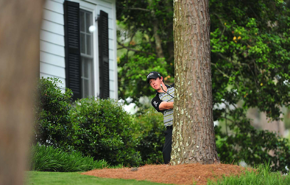 Trying to become the second youngest player to win the Masters, McIlroy's four-shot lead at the start of the day quickly vanished, but he still went into the back nine tied for the lead. Then McIlroy tripled No. 10 (pictured), four-putted for double bogey on No. 12, and when his tee shot found Rae's Creek on 13, his hopes for a green jacket were over.