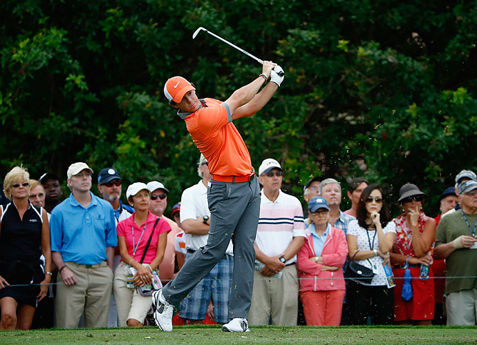 Rory McIlroy shot a blistering seven-under 63 to take the first-round lead.