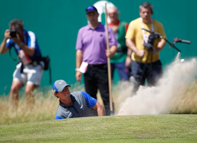 Rory McIlroy gets up and down out of a greenside bunker. He did not make a bogey in his opening round 66.