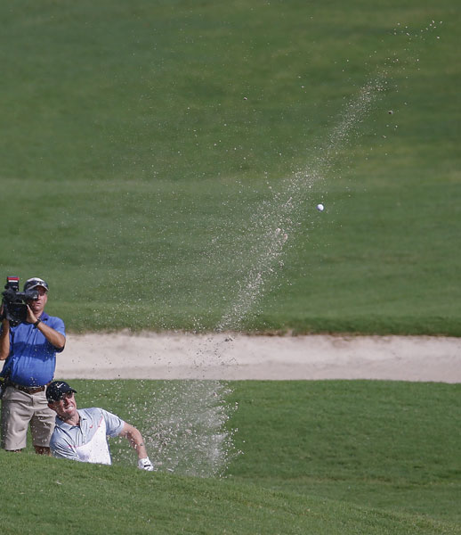 Rory McIlroy's second round included a par save after hitting his a tee shot into a fan's pocket.