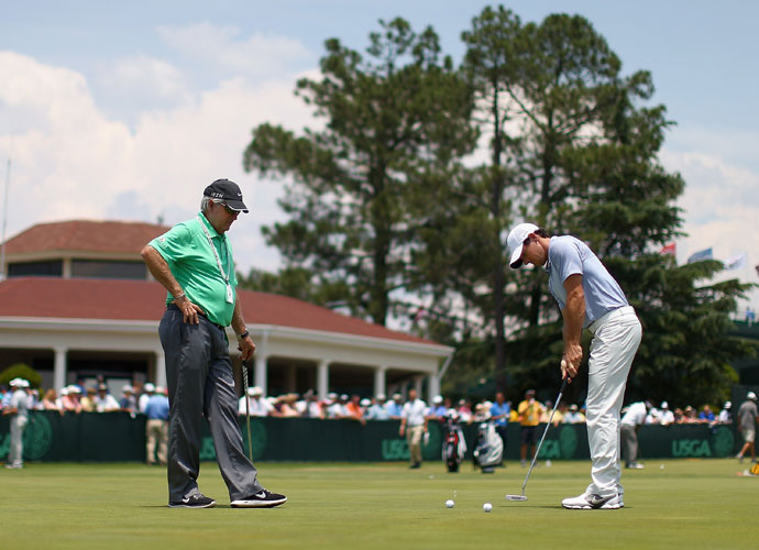 Rory McIlroy works on his putting with Dave Stockton during a practice session on the Pinehurst putting green.