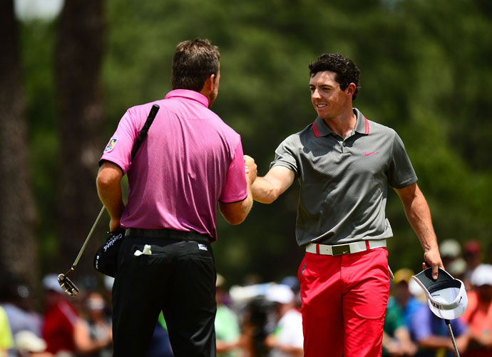 "Northern Ireland's Rory McIlroy and Graeme McDowell shake hands after completing their opening round. McIlroy shot a 1-over 71. ""I played beautifully from tee-to-green and am really happy with that,"" McIlroy said. ""I'm just going to work a little bit on my speed on the greens and if I can get that dialed in then I'm pretty confident going into the next three days."""