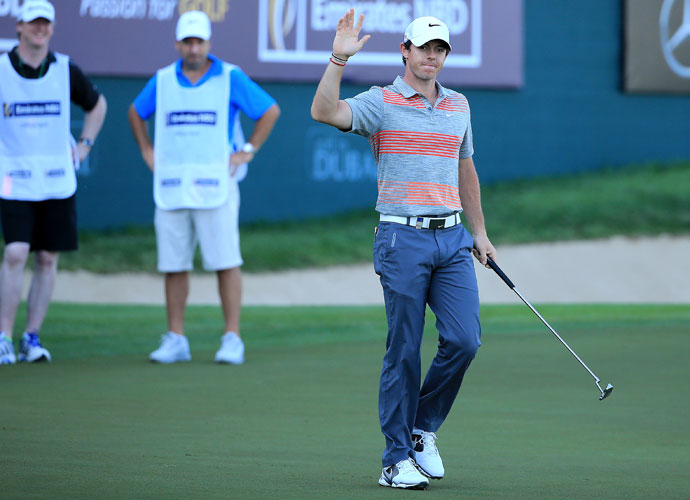 Rory McIlroy acknowledges the crowd after making an eagle putt on the 18th hole during the Champions Challenge.