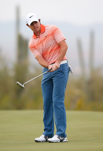 Rory McIlroy putts in his first-round match against Boo Weekley. He won, 3 and 2.