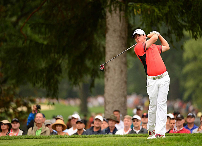 Rory McIlroy struggled mightily at first before fighting back to finish with a 71.