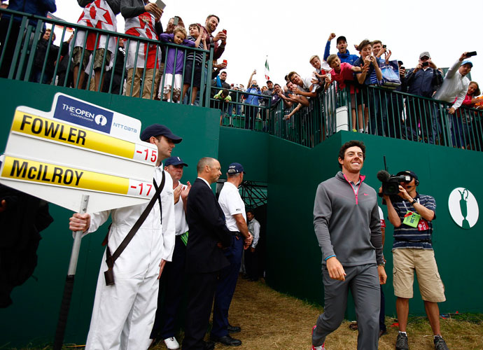Rory McIlroy makes his way to receive the Claret Jug. The 25-year-old will have a chance to claim his second consecutive major in the PGA Championship next month at Valhalla.