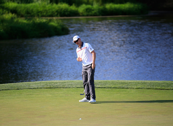 After retrieving his ball, taking a drop and chipping onto the green, Rose drained a 15-foot putt (his longest of the day) to save bogey and retain a share of the lead.