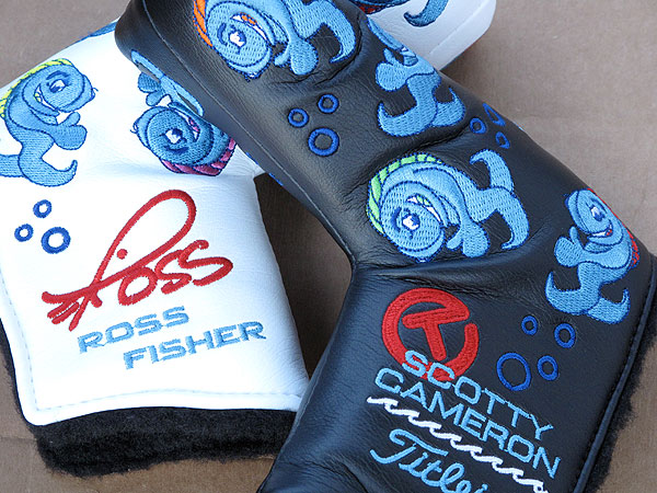 was presented Tuesday with two unique, custom putter headcovers by Scotty Cameron, Titleist's putter designer.
