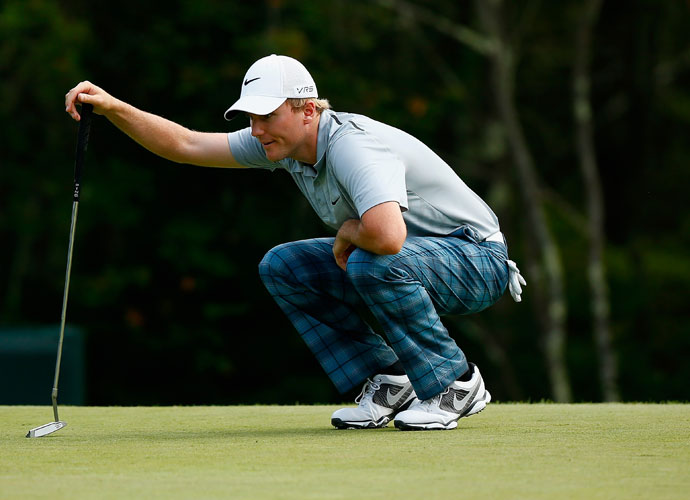 Russell Henley made five birdies in a seven-hole stretch Sunday, firing a 6-under 65 to take a one-shot lead heading into the final round of the Deutsche Bank Championship at TPC Boston.