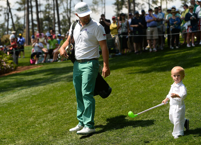 Ryan Moore walks with son Tucker.