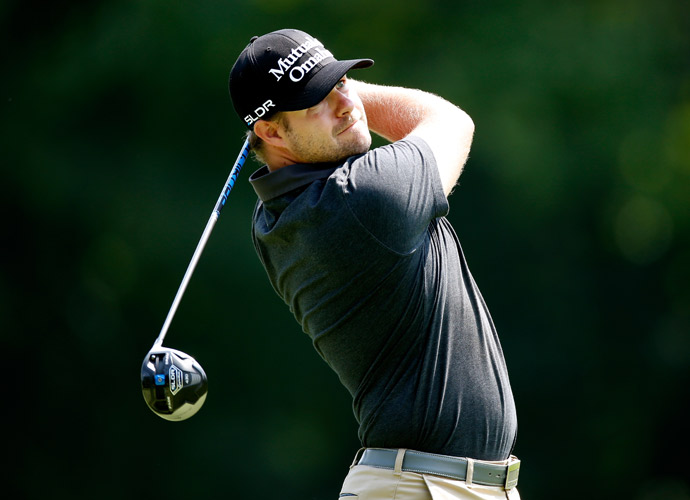 Ryan Moore shot a five-under 65 in the morning to get into a three-way tie for second at five under.